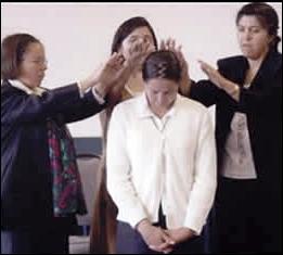 Margarita receives a blessing.