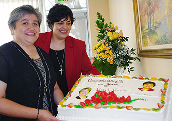 Sisters Marisol and Marcia admire the cake adorned with their images.