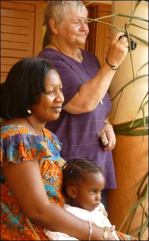 Sr. Mary Wilson with Marie-Joseph MBALLA, communications director for Afrique Future, and a child.
