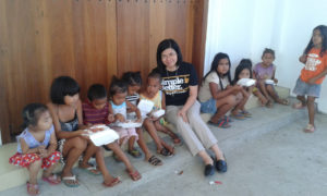 Sister  surrounded by children in Philippines
