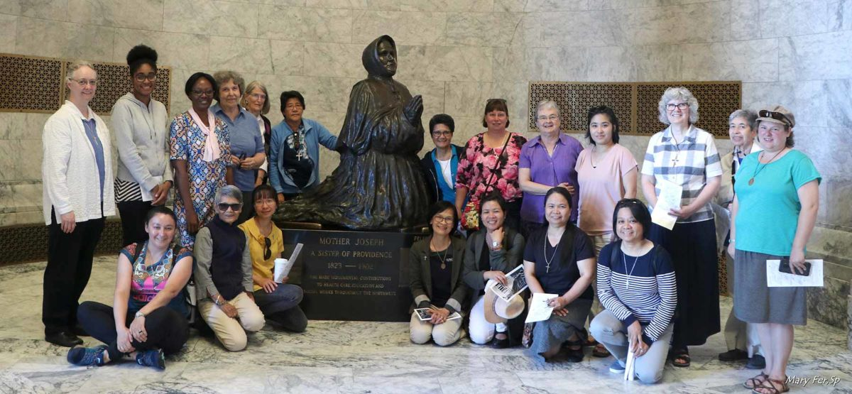 Sisters gather around statue of Mother Joseph
