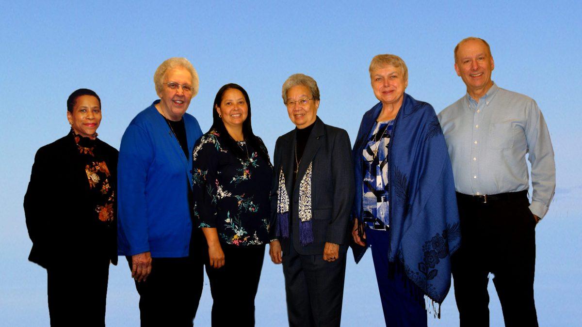 group photo of 6 leadership team members standing in a row