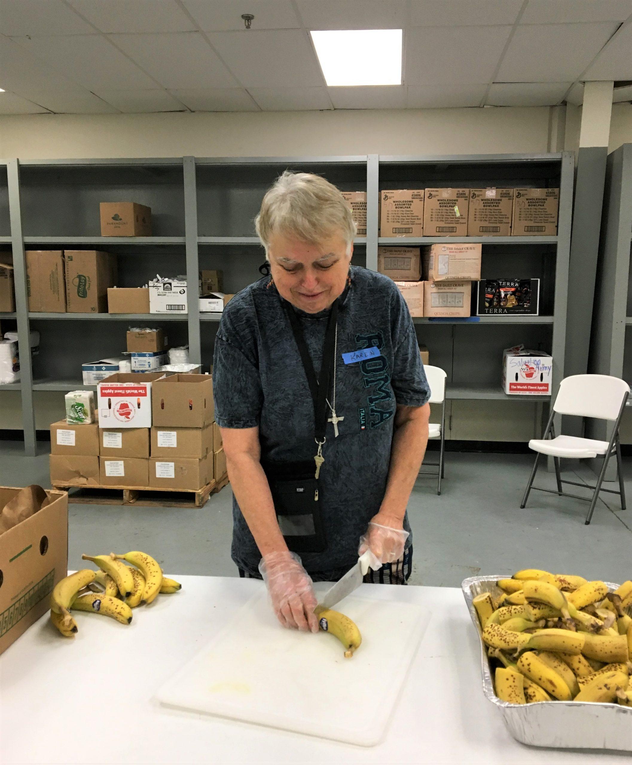 Sister Karen cuts fruit for immigrants at Texas border