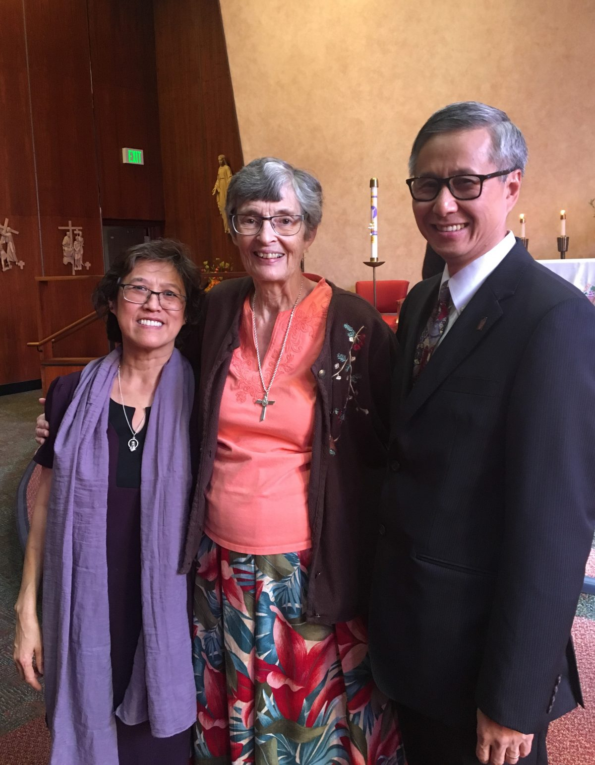 Lana Pham, Sr Clare and Tim Pham closeup in front of altar