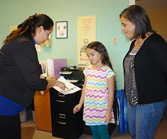 Sister Margarita shares information about classes with Berney Neal and her daughter Cecilia.