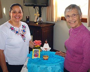 Sister Margarita shares prayer time with Sister Margaret Botch.