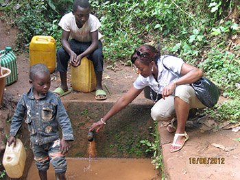 Marie-Therese at well with children