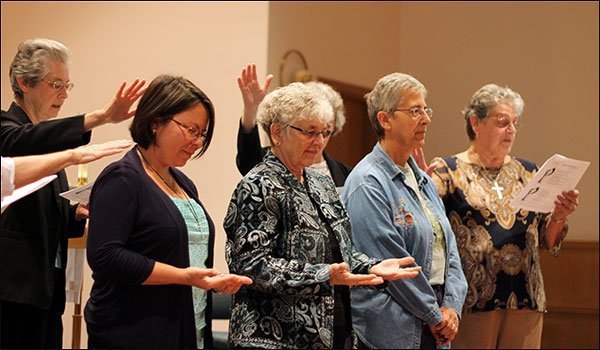 Sisters Annette Seubert and Vilma Franco were blessed, embraced and offered good wishes as they prepared to travel to El Salvador. Sister Sue Orlowski was missioned to Chile.