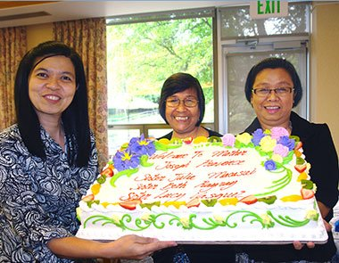 New sisters celebrate with a cake