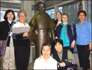 Sisters with a statue of Mother Joseph