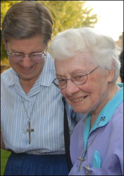 Sr. Rita enjoys a happy moment with Sr. Jeanette Heindl.