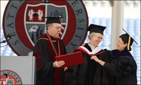 Sister Shirley Smith accepts congratulations from Seattle U president Phyllis Campbell