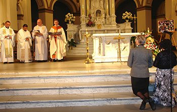 Sisters Vilma and Kathryn Rutan listen to Bishop Blase J. Cupich