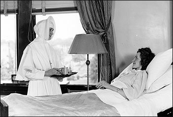 Sister cares for a patient at Providence Hospital Seattle in 1930s